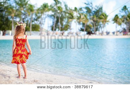 Little girl wearing Polynesian dress at beach on Bora Bora