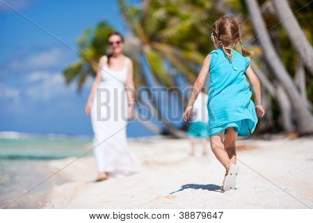 Beautiful family enjoying vacation at tropical island