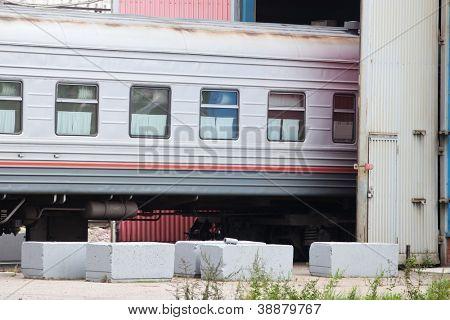 passenger coach in a depot
