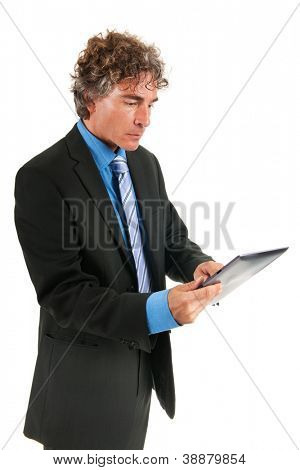 Business man with digital tablet standing in the studio isolated over white background