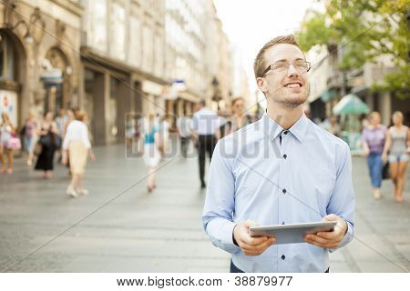 Businessman Using Tablet Computer in public space