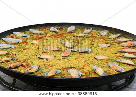 paella being cooked isolated on white