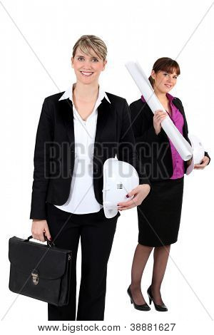 An architect standing in front of her colleague