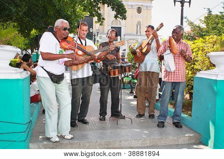 SANTIAGO-JAN. 21:Street musicians on January 21, 2010 in Santiago,Cuba.With the expansion of tourism,many cubans earn their lives working for tourists as street performers playing traditional music
