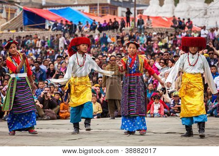 LEH, INDIA - SEPTEMBER 08: Young dancers in traditional Ladakhi Tibetan costumes perform folk dance at the Annual Festival of Ladakh Heritage in Leh, India. September 08, 2012