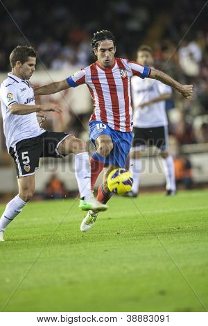 VALENCIA - NOVEMBER 3: Gago left and Arda during Spanish Cup match between Valencia CF and AT Madrid, on November 3, 2012, in Mestalla Stadium, Valencia, Spain