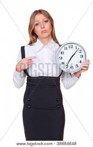 sad businesswoman pointing finger at the clock. isolated on white background