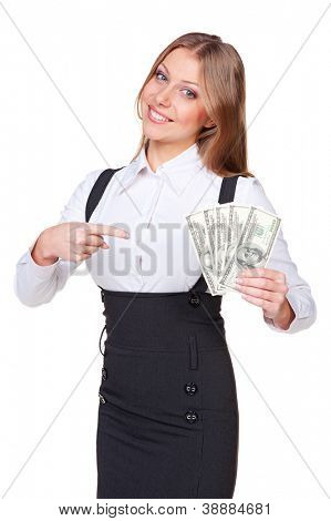 smiley businesswoman pointing finger at the money and looking at camera. studio shot over white background
