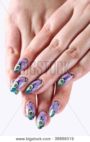 Woman hands with beautiful artistic nails ornament on a white
