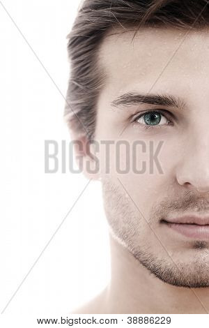 Charming and handsome man half face close up