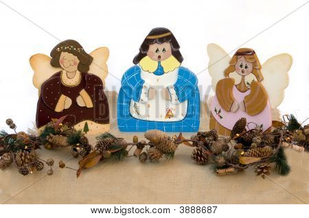 Three Figurine Christmas Choir Angels Isolated In White