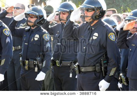 Motorcycle Officers Saluting