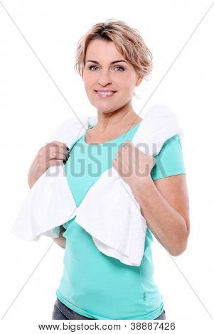 Beautiful mid aged woman with towel isolated on a white