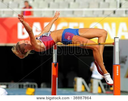 BARCELONA - JULY, 11: Anne Engen Andersen of Norway jumping on Hight jump event of of the 20th World Junior Athletics Championships at the Olympic Stadium on July 11, 2012 in Barcelona, Spain