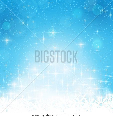 Abstract blue festive background with out of focus light dots, stars and snowflakes. Great for the festive season of Christmas or any winter theme.