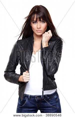 Glamorous young woman in black leather jacket on white background