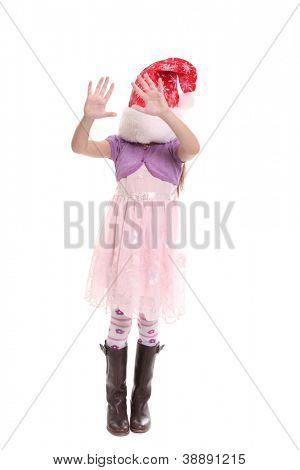 Portrait of happy little girl in Santa hat isolated on white background