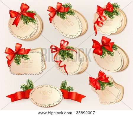 Set of christmas retro labels with red gift bows with ribbons. Vector