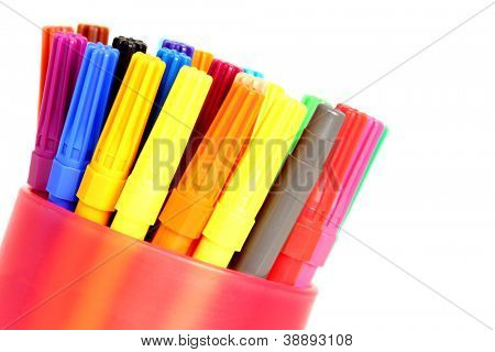 Colorful pen in a holder isolated on white background from corner