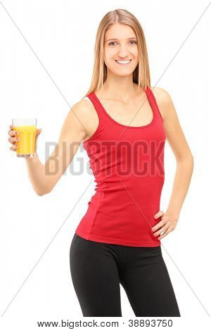 Female athlete holding a glass of orange juice, refreshing after an exercise, isolated on white background