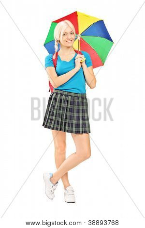 Full length portrait of a female student holding an umbrella isolated against white background