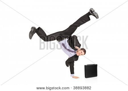 A happy businessman talking on a mobile phone and standing on a hand isolated on white background
