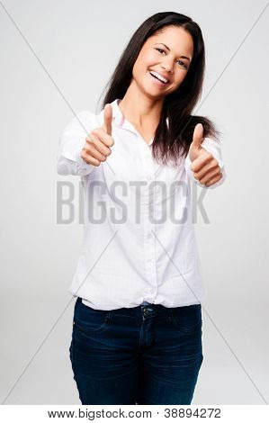 thumbs up woman celebrating success and happy isolated on grey background