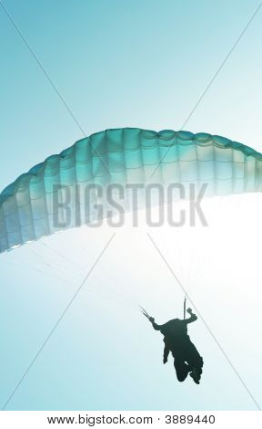 Paraglider On Sunny Background
