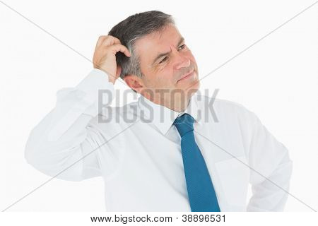 Thinking businessman scratching his head