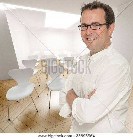 Smiling confident man in a conference room