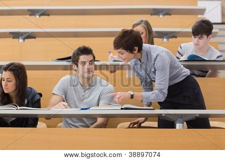 Teacher helping student at the lecture hall
