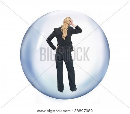 Businesswoman standing at a bubble reverse while holding her head