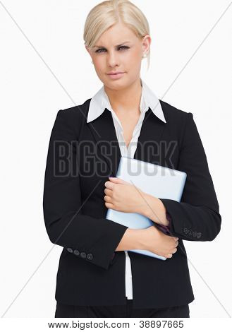 Serious businesswoman holding a tactile tablet against white background