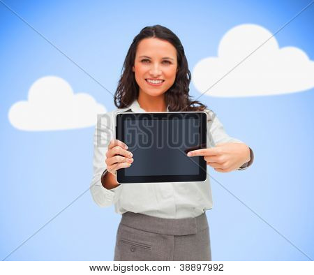 Businesswoman standing while smiling and holding a tablet pc on cloud computing background