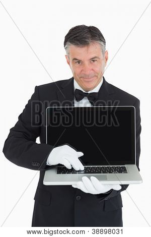 Waiter showing us something on a laptop in front of camera