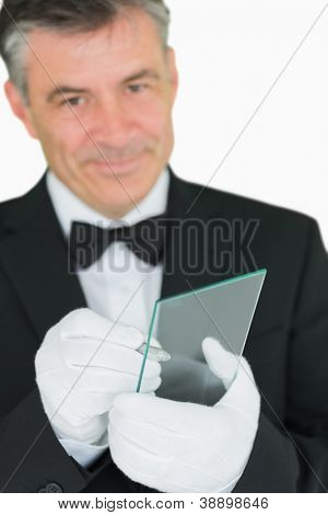 Smiling waiter using virtual screen to take orders