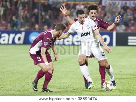 CLUJ-NAPOCA, ROMANIA - OCTOBER 2: Ivo Pinto, van Persie and Aguirregaray in UEFA Champions League match between CFR 1907 Cluj and Manchester United, on 2 Oct., 2012 in Cluj-Napoca, Romania