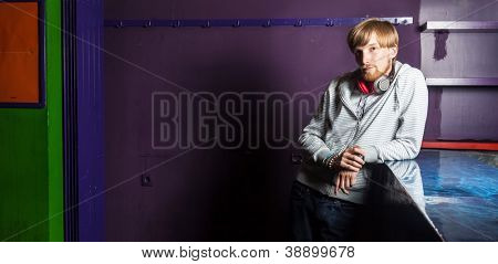 Cool urban style young man with red hair in cool location