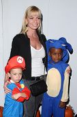 LOS ANGELES - OCT 27:  Jaime Pressly arrives at EBMRF And PlayStation Epic Halloween Bash at Private