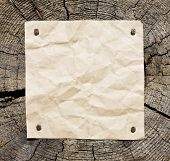 Image of old paper on wooden background. Ready for your message. Tags and labels series.