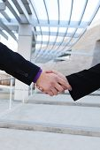 A man and woman handshake to conclude a successful business deal