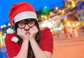 excited christmas woman with her eyes shut, outdoor