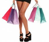 picture of up-skirt  - Close up of sexy woman legs in shoes and shopping bags isolated on a white - JPG