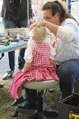 TULSA, OK - OCT 20: Young Oktoberfest goer gets her face painted at Oktoberfest in TULSA, OK, on Oct