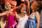 image of night-club  - Photo of joyful teenage girls having fun on dance floor - JPG