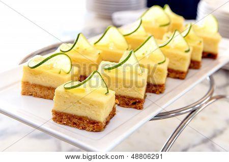 Mini Lemon Cheese Cake On White Dish