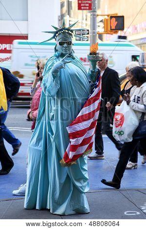 Artist Imitating Statue Of Liberty