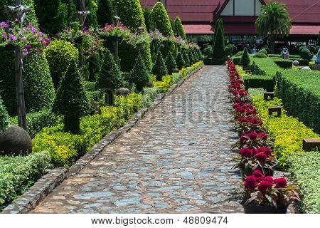 English garden in summer, Lush Green Topiary