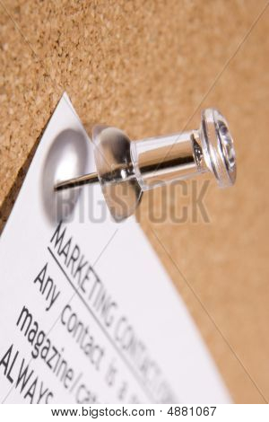 Thumbtack In Bulletin Board