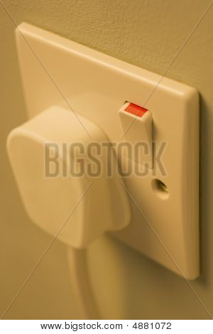 Electric Plug Connected To Outlet
